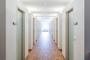 hallway of Multifamily housing with unit doors in close proximity